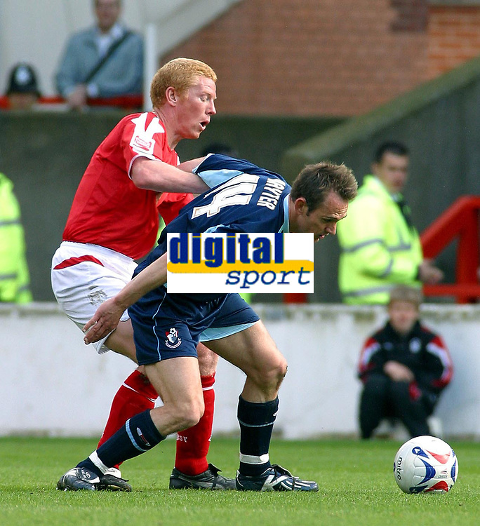 Photo: Dave Linney.<br />Nottingham Forest v Bournemouth. Coca Cola League 1. 29/04/2006.Forest's Gary Holt(L) closes in on  James Hayter