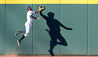 California's Aaron Knapp (23) attempts to make a catch on a home run ball hit by Texas A&M's Ryne Birk during a NCAA Regional baseball game at Blue Bell Park in College Station, Texas on Sunday, May 31, 2015.  Texas A&M won 4-3 in 12 innings.