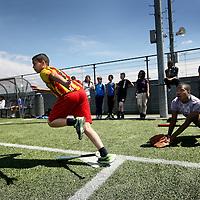 Nederland, Amsterdam , 22 mei 2014.<br /> De OSB (Open School Bijlmer) is uitgeroepen tot de sportiefste school van Amsterdam en Nederland.<br /> Op de foto: leerlingen van OSB tijdens de gymles buiten.<br /> Foto:Jean-Pierre Jans