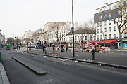 "March, 17th, 2020 - Paris, Ile-de-France, France: An almost deserted Paris Belleville, and 11th district, as many French citizens practice self isolation and confinement in their homes, to combat the spread of Coronavirus. Some walk the city streets wearing masks and gloves. During the first day of near total lockdown imposed in France. The day before, President of France, Emmanuel Macron, said the citizens must stay at home from midday on Tuesday for at least 15 days. He said ""We are at war, a public health war, certainly but we are at war, against an invisible and elusive enemy"". All journeys outside the home unless justified for essential professional or health reasons are outlawed. Anyone flouting the new regulations would be punished. Nigel Dickinson"