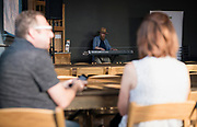 """Composer Patrick Christians plays piano before the live taping of the """"Corner Table Podcast"""" at Old Sugar Distillery in Madison, Wisconsin, Tuesday, June 18, 2019."""