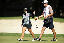 May 26, 2018 - Ann Arbor, Michigan, United States - Moriya Jutanugarn of Thailand and her caddy walk off the 6th green during the third round of the LPGA Volvik Championship at Travis Pointe Country Club, Ann Arbor, MI, USA Saturday, May 26, 2018. (Credit Image: © Jorge Lemus/NurPhoto via ZUMA Press)