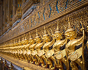 Figurines at the Emerald Buddha Temple at the Royal Palace in Bangkok, Thailand<br /> .....<br /> The Grand Palace is a complex of buildings at the heart of Bangkok, Thailand. The palace has been the official residence of the Kings of Siam (and later Thailand) since 1782. The king, his court and his royal government were based on the grounds of the palace until 1925. King Bhumibol Adulyadej (Rama IX), resided at Chitralada Royal Villa in the Dusit Palace, but the Grand Palace is still used for official events. Several royal ceremonies and state functions are held within the walls of the palace every year. The palace is one of the most popular tourist attractions in Thailand.<br /> Construction of the palace began on May 6, 1782, at the order of King Buddha Yodfa Chulaloke (Rama I), the founder of the Chakri Dynasty, when he moved the capital city from Thonburi to Bangkok. Throughout successive reigns, many new buildings and structures were added, especially during the reign of King Chulalongkorn (Rama V). By 1925, the king, the Royal Family and the government were no longer permanently settled at the palace, and had moved to other residences. After the abolition of absolute monarchy in 1932, all government agencies completely moved out of the palace.<br /> It is situated on the banks of the Chao Phraya River at the heart of the Rattanakosin Island, today in the Phra Nakhon District. Rather than being a single structure, the Grand Palace is made up of numerous buildings, halls, pavilions set around open lawns, gardens and courtyards. Its asymmetry and eclectic styles are due to its organic development, with additions and rebuilding being made by successive reigning kings over 200 years of history. It is divided into several quarters: the Temple of the Emerald Buddha; the Outer Court, with many public buildings; the Middle Court, including the Phra Maha Monthien Buildings, the Phra Maha Prasat Buildings and the Chakri Maha Prasat Buildings; the Inner Court and the Siwalai Gardens quarter. Th
