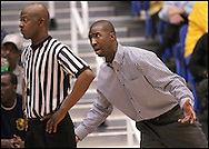 CAN YOU HEAR ME NOW!!!!!<br /> During a basketball game on any level, the relationship between coaches and officials are always interesting but the photo of Marist High School's coach Greg McClaire complaining about a call and being ignored by official Andrew Wilkey on Friday, March 6, 2009, at the University of West Georgia during the Georgia High School Association's 2009 High School Basketball Quarterfinals was priceless.  During a break in the game, I showed the photo to the official and he just smiled.  ©2009 Johnny Crawford