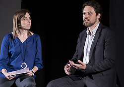 May 4, 2019 - Barcelona, Catalonia, Spain - The journalist and board member of Ã'mnium, Claudia Pujol seen accompanying Jordi Cuixart's defence lawyer Olivier Peter on stage during the presentation of The evidence forbidden by the Supreme Court..Marcel Mauri de los Rios, spokesman for the pro-independence association Omnium Cultural,  and Olivier Peter, defence lawyer for Jordi Cuixart, have participated at the event The prohibited evidence of the Supreme Court, uncovered, organized by Omnium Cultural consisted in the viewing  videos of the police repression during the election day of October 1. The judge of the Spanish Supreme Court, Manuel Marchena, does not allow the viewing of these videos during the testimony of the witnesses. According to Judge Marchena, videographic evidence must be viewed jointly before the end of the process. (Credit Image: © Paco Freire/SOPA Images via ZUMA Wire)