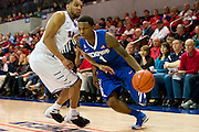 DALLAS, TX - FEBRUARY 01: Joe Jackson #1 of the Memphis Tigers drives to the basket against Nick Russell #12 of the SMU Mustangs on February 1, 2014 at Moody Coliseum in Dallas, Texas.  (Photo by Cooper Neill/Getty Images) *** Local Caption *** Joe Jackson