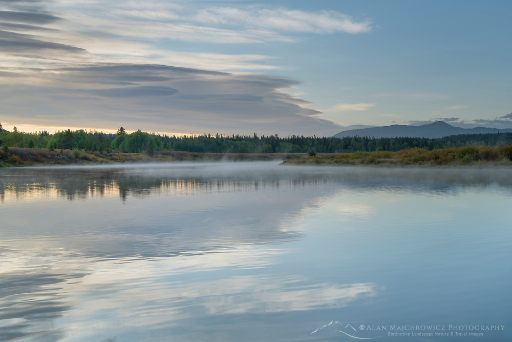 Clouds mirrored in still waters of the Snake River at Oxbow Bend at sunrise, Grand Teton National Park Wyoming