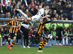 Swansea's Ben Davies fouls Hull's Sone Aluko - Photo mandatory by-line: Matt Bunn/JMP - Tel: Mobile: 07966 386802 05/04/2014 - SPORT - FOOTBALL - KC Stadium - Hull - Hull City v Swansea City- Barclays Premiership
