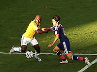 Fifa Soccer World Cup - Brazil 2014 - <br /> JAPAN (JPN) Vs. COLOMBIA (COL) - Group C - Arena Pantanal Cuiaba - Brazil (BRA) - June 24, 2014 <br /> Here Colombia player Pablo Armero (L) and Japanese player Atsuto Uchida (R). Possible penalty.<br /> © PikoPress