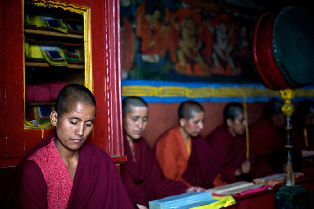 Nuns recite prayers during a ceremony at Giabong Monastery in the Ropa Valley, Himachal Pradesh, India
