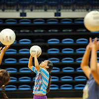 062314  Adron Gardner/Independent<br /> <br /> Campers practice their form at the lady Scout volleyball camp at the Stronghold Events Center in Fort Defiance Monday.