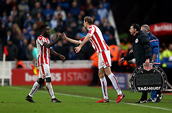 Stoke City's Peter Crouch replaces Mame Biram Diouf during the Premier League match at the bet365 Stadium, Stoke.