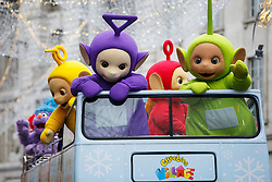 © Licensed to London News Pictures. 20/11/2016. London, UK. Performers dressed as Teletubbies wave at children as over 400 cast members of Hamley's Toy Parade march along Regent Street in London in a colourful extravaganza, with marching bands, dancers and toy vehicles. Photo credit: Tolga Akmen/LNP