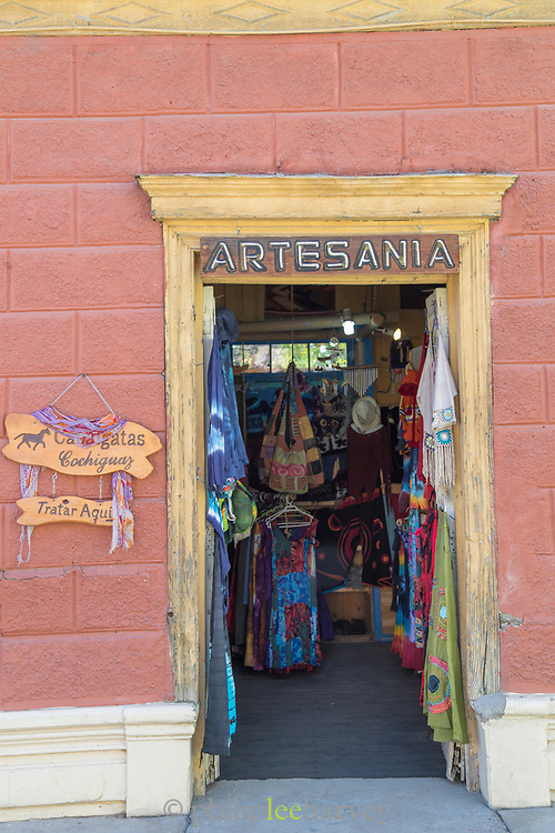 Entrance to clothing shop on city street, Pisco Elqui, Equi Valley, Chile
