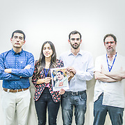 2018<br /> Juan Carlos Claret, Catalina Venegas, Fernando Brierley and Jose Andres Murillo, survivors and activists from Chile, pose for a portrait showing a picture of the Chilean bishop Juan de la Cruz Barros Madrid who covers up Fernando Caradima sexual abuses on seminarists, children and priests. © Simone Padovani