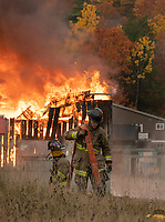 Gilford Fire Dept practice training exercises during a controlled burn of the Phelps Barn at Gunstock.  Karen Bobotas Photo/ for the Laconia Daily Sun