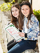 07/04/2019 repro free: Jenna Inns and Isabel O'Shaughnessy from Gaelscoile Dí hides with thier book Timpistre Dhaidi Na Nollaig  at Scriobh Leabhair organised by The Galway Education centre and help at the Salthill Hotel  . Photo: Andrew Downes, Xposure