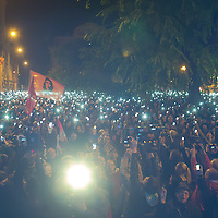 Participants hold their phones in the air to protest against the planned Internet tax in front of the Ministry for National Economy in Budapest, Hungary on October 28, 2014. ATTILA VOLGYI