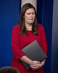 August 2, 2017 - Washington, District of Columbia, United States of America - White House press secretary SARAH HUCKABEE SANDERS reacts as she listens to senior advisor for policy Stephen Miller conducting a press briefing on the Trump Administration's support of the Reforming American Immigration for a Strong Economy (RAISE) Act in the Brady Press Briefing Room. (Credit Image: © Ron Sachs/CNP via ZUMA Wire)