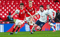 LONDON, ENGLAND - MARCH 31: Krzysztof Piatek of Poland competes with Declan Rice of England during the FIFA World Cup 2022 Qatar qualifying match between England and Poland on March 31, 2021 in London, United Kingdom. Sporting stadiums around the UK remain under strict restrictions due to the Coronavirus Pandemic as Government social distancing laws prohibit fans inside venues resulting in games being played behind closed doors. (Photo by Wlosek/PressFocus/MB Media)