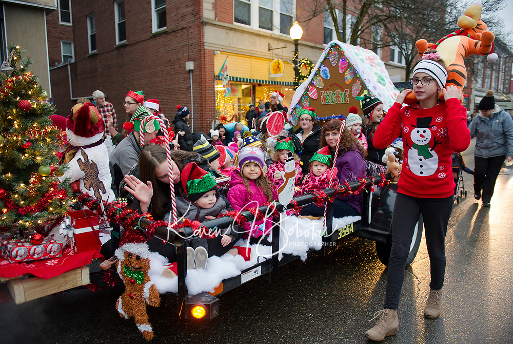 Dreams of Christmas from the Open Door Preschool and Daycare float as they go down Main Street during the Light Up Laconia Hoiliday Parade Sunday afternoon.  (Karen Bobotas/for the Laconia Daily Sun)