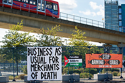London, UK. 5 September, 2019. Banners outside ExcelLondon by activists taking part in a week-long carnival of resistance against DSEI, the world's largest arms fair.