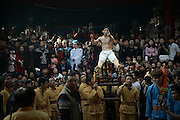 """PUTIAN, CHINA - FEBRUARY 20: <br /> <br /> Mans back Beaten With Thorny Iron Ball during Ceremony <br /> <br /> Villagers in Putian hold the \""""Da Tie Qiu\"""" event on Feb 24 in lunar calendar to commemorate Qi Jiguang, a national hero in Ming dynasty. During the event, selected unmarried men baring their upper bodies and feet sit on the knife-made palanquins and beat their backs with thorny iron balls. Beating back with an iron ball stuck with 360 steel nails is said to encourage men to guard the safety of their home and country.<br /> ©Exclusivepix Media"""