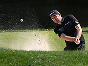 Keegan Bradley hits out of a bunker on the eighth hole the final round of the Travelers Championship golf tournament, Sunday, June 23, 2019, in Cromwell, Conn. Bradley made par. (AP Photo/Jessica Hill)