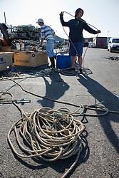 Mending crab pots on harbour side