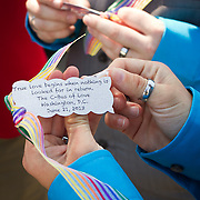 Bubbles with messages were handed out to the twenty-five gay couples that participated in getting married en masse in front of the Supreme Court of the United States, on June 21, 2013.  John Boal photography