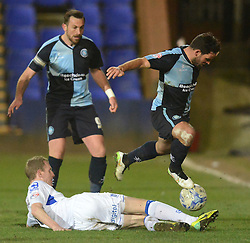 Wycombe Wanderers's Sam Wood hurdles the tackle of Tranmere Rovers's Marc Laird - Photo mandatory by-line: Richard Martin-Roberts/JMP - Mobile: 07966 386802 - 03/03/2015 - SPORT - football - Tranmere - Prenton Park - Tranmere Rovers v Wycombe Wanderers - Sky Bet League Two