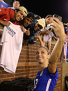 CHATTANOOGA, TN - AUGUST 19:  Forward Alex Morgan #13 of the United States takes a selfie with fans after the friendly match against Costa Rica at Finley Stadium on August 19, 2015 in Chattanooga, Tennessee.  (Photo by Mike Zarrilli/Getty Images)