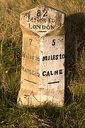 Old milestone road marker on A4 road Beckhampton, Wiltshire, England, UK