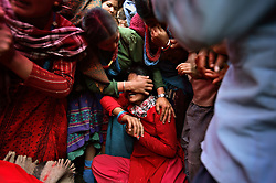 Saraswati Sheshta Balami, 14, the sister of bride Sumeena Shreshta Balami, 15, cries as the groom's family takes Sumeena away in Kagati Village, Kathmandu Valley, Nepal on Jan. 24, 2007. The Kagati village, a Newar community, is most well known for its propensity towards early marriage. Many Hindu families believe blessings will come upon them if marry off their girls before their first menstruation.