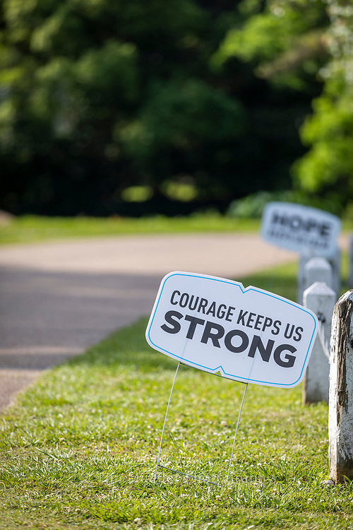 Signs stationed along roads and pathways in Baton Rouge offer encouragement and humor during the coronavirus pandemic.