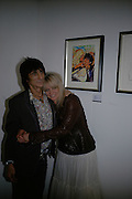 Ronnie and Jo Wood, Ronnie Wood: Josephine - private view , Scream, 34 Bruton Street, London, W1. 29 March 2007. Rolling Stones  guitarist celebrates 22 years of marriage with exhibition of 60 oil paintings and watercolours of his wife.  -DO NOT ARCHIVE-© Copyright Photograph by Dafydd Jones. 248 Clapham Rd. London SW9 0PZ. Tel 0207 820 0771. www.dafjones.com.