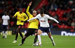 Watford's Etienne Capoue (left) and Tottenham Hotspur's Erik Lamela battle for the ball during the Premier League match at Wembley Stadium. London.
