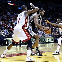 17 January 2012: San Antonio Spurs center Tim Duncan (21) drives past Miami Heat power forward Chris Bosh (1) and Miami Heat small forward James Jones (22) during the Miami Heat 120-98 victory over the San Antonio Spurs at the AmericanAirlines Arena, Miami, Florida, USA.