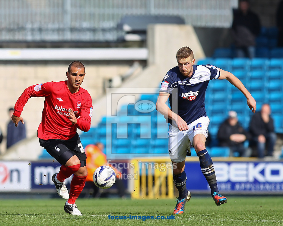 Picture by John Rainford/Focus Images Ltd +44 7506 538356.27/04/2013.Mark Beevers of Millwall and Marcus Tudgay of Nottingham Forest chase a loose ball during the npower Championship match at The Den, London.