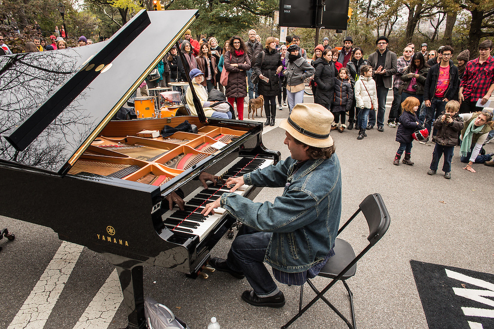 A crowd watches Eli Yamin play the blues between the formal sets of the Jazz and Colors festival in Central Park.