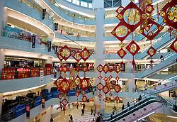 Interior of modern shopping mall in Wangfujing Beijing China