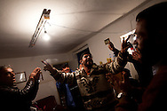 Protesters organizers celebrate in an apartment in Banghazi on Feb. 25, 2011.