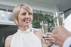 Close-up couple party date champagne toasting