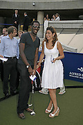 SALOUM N'JIE AND ANNA ZOUMARAS, Alfred Dunhill Million Dollar Putt, the Dunhill Clubhouse. Broadgate Arena.London EC2. 25 July 2006.  ONE TIME USE ONLY - DO NOT ARCHIVE  © Copyright Photograph by Dafydd Jones 66 Stockwell Park Rd. London SW9 0DA Tel 020 7733 0108 www.dafjones.com