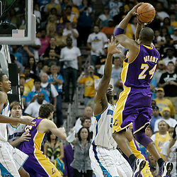April 24, 2011; New Orleans, LA, USA; Los Angeles Lakers shooting guard Kobe Bryant (24) shoots over New Orleans Hornets center Emeka Okafor (50)during the fourth quarter in game four of the first round of the 2011 NBA playoffs at the New Orleans Arena. The Hornets defeated the Lakers 93-88.   Mandatory Credit: Derick E. Hingle