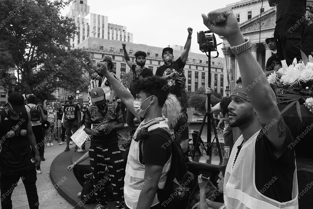 NEW YORK, NEW YORK:  BLM demonstrators rally at the Triumph of the Human Spirit Sculpture at Foley Square in New York on Thursday June 11, 2020. Day 17 since the killing of George Floyd by Minneapolis, Minnesota Police officer Derek Chauvin.  (Brian Branch-Price/TheFotoDesk.)