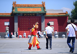 July 4, 2017 - Shenyan, Shenyan, China - Shenyang, CHINA-July 4 2017: (EDITORIAL USE ONLY. CHINA OUT)...A man wearing costume of Monkey King can be seen in front of the Palace Museum in Shenyang, northeast China's Liaoning Province. The man takes photo with tourists and later ask them for payment of 15 yuan  (Credit Image: © SIPA Asia via ZUMA Wire)