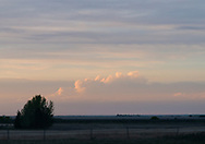 Soft pastel colors fill the spring prairie skies