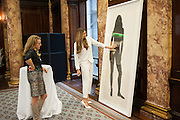 NICOLA GREEN; ELLE MACPHERSON WITH ONE OF THE BODY PRINTS; , A unique portrait of Elle Macpherson by Nicola Green is unveiled at the Australian High Commission at a reception hosted by His Excellency Mike Rann. London. 19 November 2013.  - Four Subsequent Life Size prints of Elle titled: The Body will go on show at London gallery: Flowers.