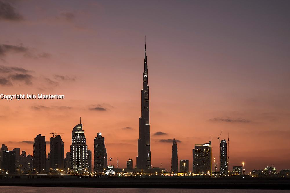 Evening skyline panorama of modern buildings and Burj Khalifa in United Arab Emirates